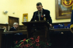 Chairman of Sheringham RBL reading lesson at Salvation Army Remembrance Service 2008